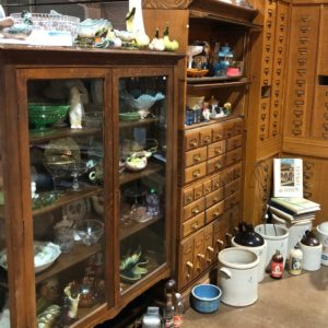 Antique furniture filled with collectible antiques